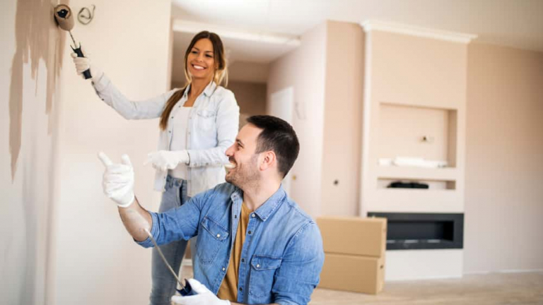 Young,Couple,Renovating,Their,Apartment,Painting,Walls,Using,Painting,Tools